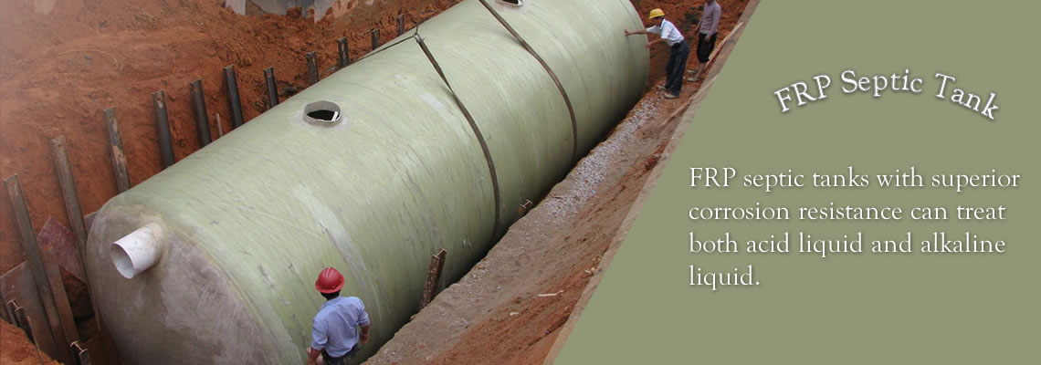 There is a nature color FRP septic tank in the trench waiting for installation.