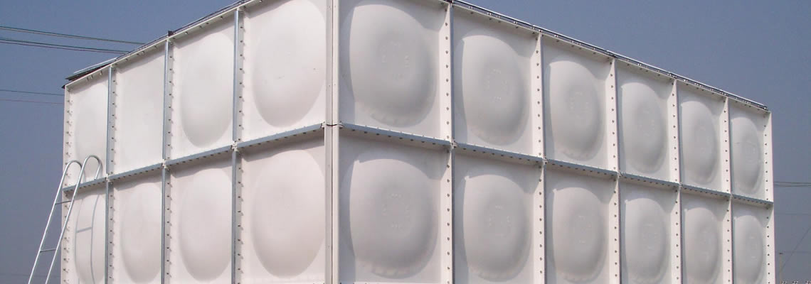 There is a white SMC water tank assembled with rectangle panels with spherical surface.